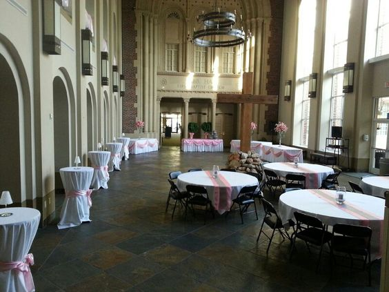 Pinks, grays, and candles grace a lovely reception venue