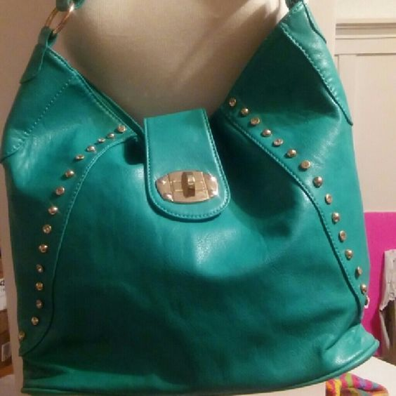 Tourqois Handbag Beautiful Turquoise Handbag with gold studded detail with a twist lock.soft leather like material Bags Shoulder Bags