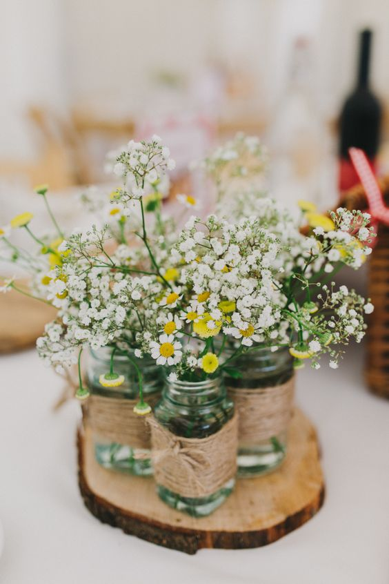 Pretty daisies and dainty gypsophilas make  perfect center pieces for a fresh, crisp spring wedding.    Image from http://peppermintlovephotography.com/