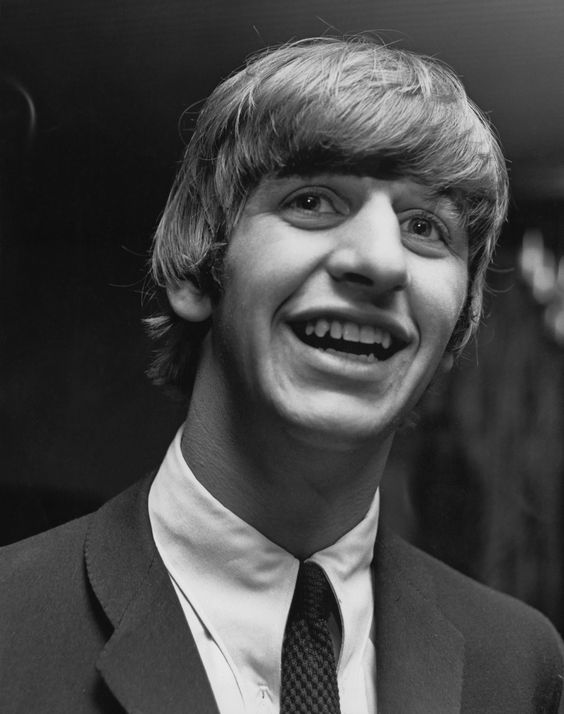 Ringo Starr from The Beatles posed behind the bar at the Wimbledon Palais in South London on 14th December 1963. (Photo by Mark and Colleen Hayward/Redferns)
