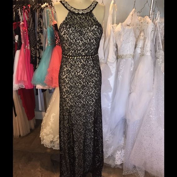 Dress Black Silver lace with white underlay halter dress trimmed in crystals and beads. Has flared insert bottom comes with crystal satin belt. Sequin Hearts Dresses