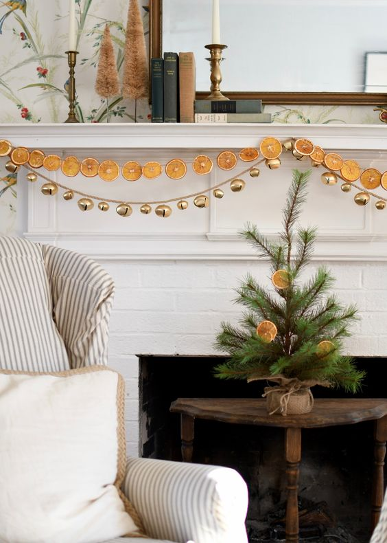 Oranges and Bells. I. Love. This. The idea is so minimal and festive without being christmas-y, or red and green. My new Jul decor. -- from ApartmentTherapy.com