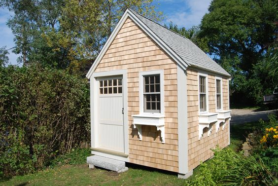 10'X12' Cape Cod Cottage featuring additional window and granite step www.saltspraysheds.com