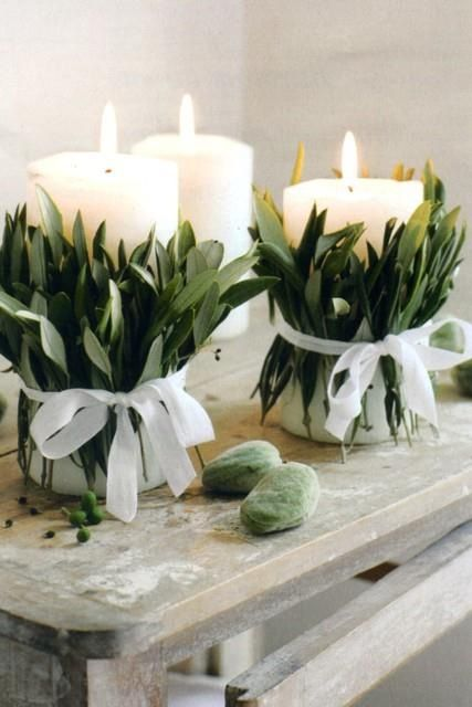 .Australian table decorations - Candle with leaves wrapped around it with ribbon -simple but elegant: