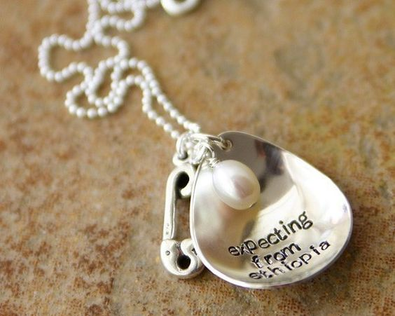 An adoption necklace...oh how I'd love to bring a sweet little person into our family and give them a forever home.