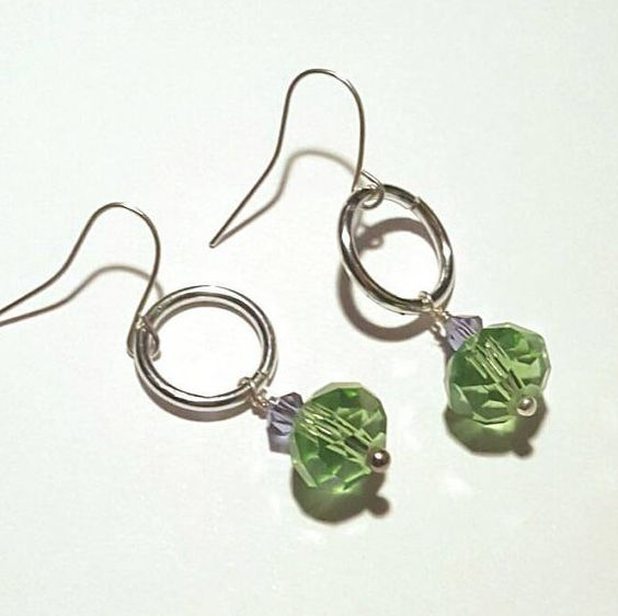 Check out this item in my Etsy shop https://www.etsy.com/listing/485356347/green-swarovski-crystal-drop-earrings