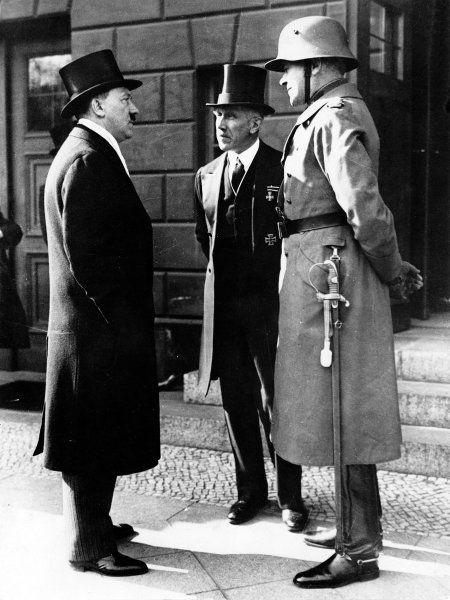(left to right) Hilter, Franz von Papen and Werner von Blomber outside…