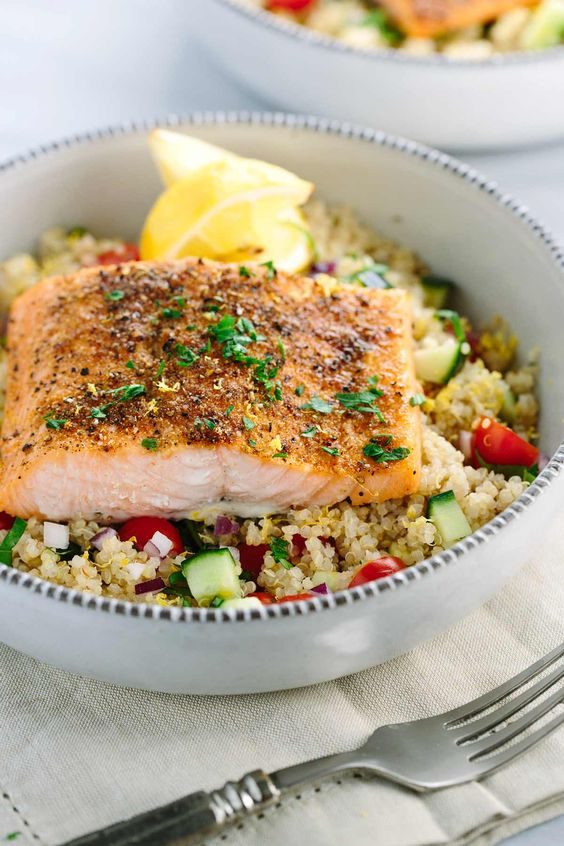 Mediterranean Spiced Salmon and Vegetable Quinoa: this healthy recipe is packed with protein packed - earthy spices roasted lemons and fresh vegetables in each bite | jessicagavin.com