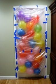 Cute idea for surprising someone on their birthday - especially kids! BALLOON AVALANCHE !!-Cut open one two plastic garbage bags. Use paper tape/masking tape to tape the bags to the outside of the door frame, leaving the top open. Blow up balloons, stuff em in, and when the birthday boy or girl opens their door in the morning  balloon avalanche! we need to do this !!!!!!