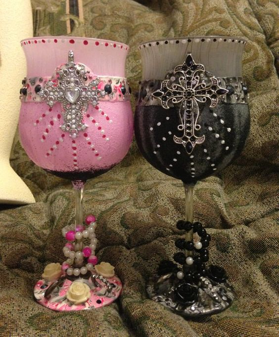 These glasses were made with enamel paint and polymer clay, rhinestones, charms and elegantly designed crosses and then covered with a mixture of fine