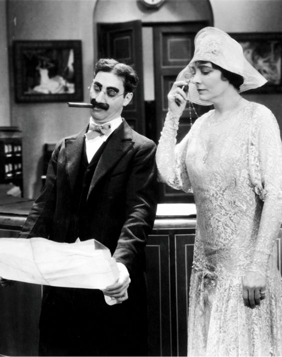 """Groucho Marx and Margaret Dumont in """"The Cocoanuts"""", 1929."""