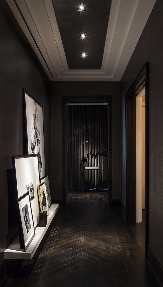 Chelsea NYC | Michael Dawkins Home... Love this Very Dramatic Hallway/Display...Using a Herringbone Design in the Flooring breaks up an otherwise boring space...: