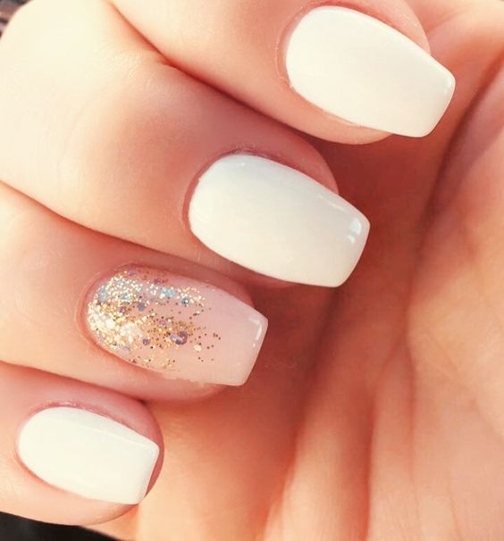 Short white coffin shaped nails with nude glitter ombré accent nail