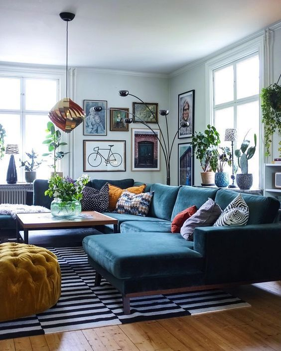 A Graphic Black And White Striped Rug Grounds The Seating Area In