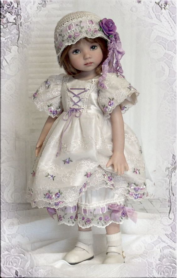 A repin of a doll by Dianna Effner, dressed in lavender (seamstress unknown to me), originally pinned from a Russian doll board: