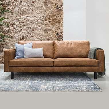Nên mua sofa da phòng khách ở đâu uy tín