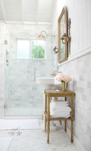 Gorgeous bathroom renovation with champagne brass marble for Cottage bathroom ideas renovate