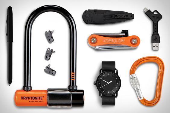 EDC: Bike Lane - Kryptonite Evolution Bicycle U-Lock ($58). TID No 1 Watch ($283). Conquer Bicycle Multitool ($9). SOG Aegis Mini Knife ($53). iPhone NomadKey ($25). KMC Bicycle Chain Half-Link ($1-9). Petzl Pro Attache Screw-Lock Carabiner ($21). Cross Tech3+ Pen with Stylus ($34). | via uncrate.com