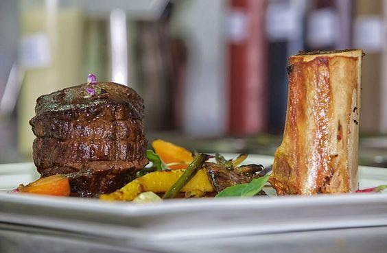 Irish beef fillet With glazed carrots, potato chip,  Portobello mushroom and roasted bone marrow