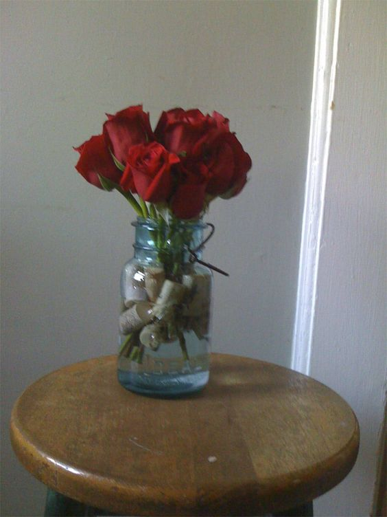 Roses in blue mason jar centerpiece wedding ideas