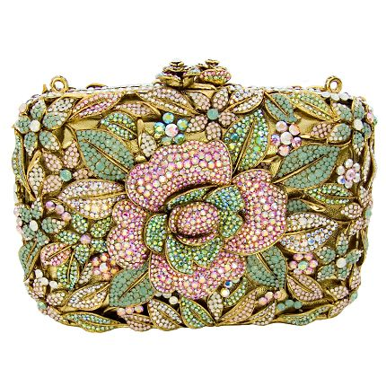 The classy flower new hard clutch is perfect for that special occasion or for a night on the town.  £650.00  ~    Featuring Swarovski crystals, the bag comes with a shoulder chain and the famous Butler  Wilson edge.