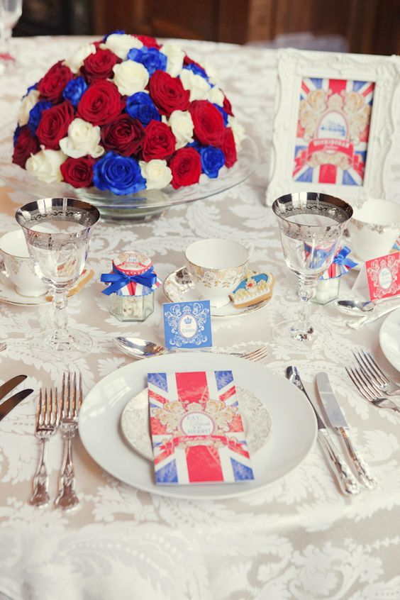 white lace, cutwork napkins, British flags.