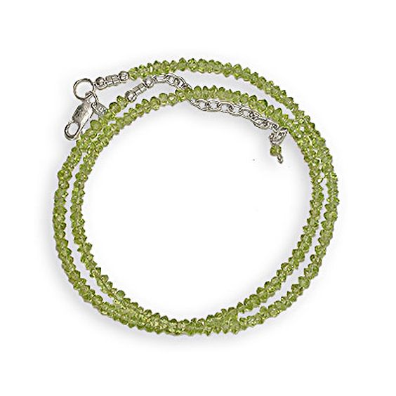 """This faceted peridot necklace contains 3mm faceted chips of peridot and is 18"""" in length and has a 2"""" extender"""