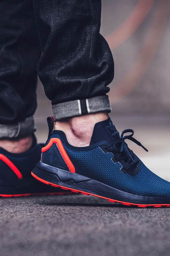 The adidas ZX Flux ADV Asymmetrical Collegiate Navy comes with Solar Red  accents.