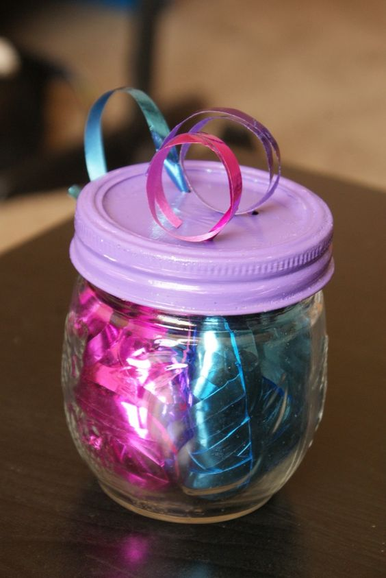 Organize curling ribbons in small jars.