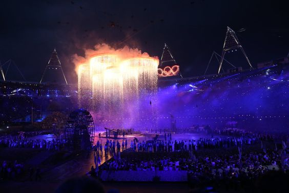 Huge Olympic rings were lowered into the stadium.