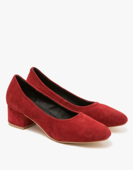 From Jeffrey Campbell, a classic suede leather small heel in Rust. Features round toe, suede uppers, leather lining, rolled cuff, small heel, matching suede covered heel, capped heel and synthetic outsole.  •Suede heel in Rust •Round toe •Leather u