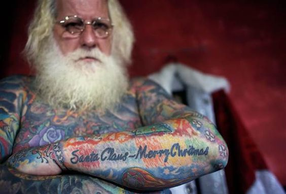Santa Claus is coming to town….and he's covered in Tattoos!