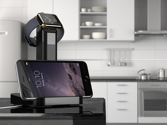 "If we had a new-fangled Apple Watch, we'd get the $30 ""WatchStand"" from Griffin Technology. It charges and displays the Watch and an iPhone on a pedestal that makes the watch look like a jewel. The iPhone leans against the lower part of the pedestal and the Watch rests on top. During setup, you thread the magnetic charging cable through the post, so it's invisible. The connector snaps onto the back of the watch. Joy was enchanted, Bob said ""eh."""