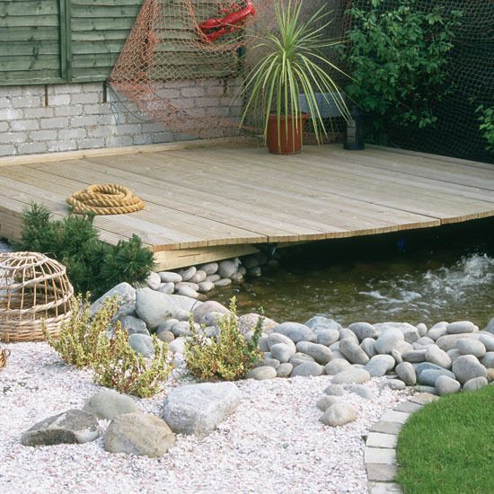 Nautical garden gardens nautical and beach styles for Garden pond edging