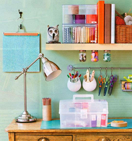 notice the baby food jars for button storage, and the ikea kitchen organizer in a craft room