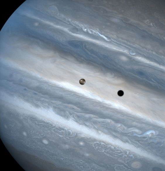 Jupiter April 20, 1999: While hunting for volcanic plumes on Io, NASA's Hubble Space Telescope captured these images of the volatile moon sweeping across the giant face of Jupiter