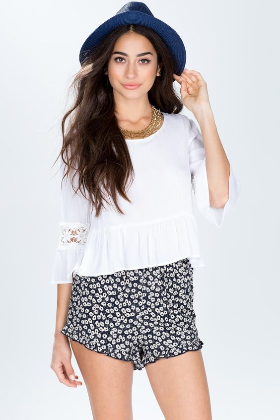 A Summer-perfect pair of soft shorts, featuring a ditsy floral print and ruffled trimming along the leg openings. Elasticized waist. Looks amazing with boxy tee and gladiator sandals. $14.90