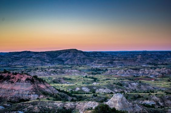 Theodore Roosevelt National Park in North Dakota honors President Theodore Roosevelt's conservation legacy. Visitors can see Roosevelt's Elkhorn Ranch Site, where he spent the bulk of his time and where many of his conservation ideas grew.