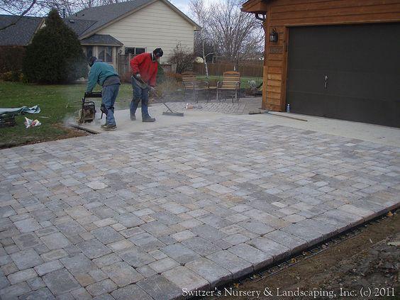 Interlocking pavers interlocking concrete paver driveway for Installing patio pavers on sand