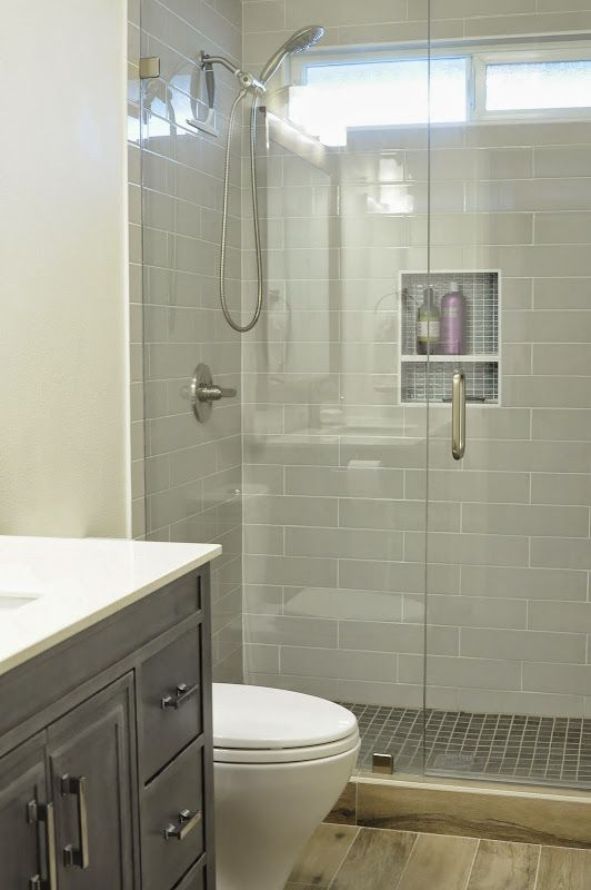 Walk in shower small bathroom with niche and brushed for Basement bathroom tile ideas