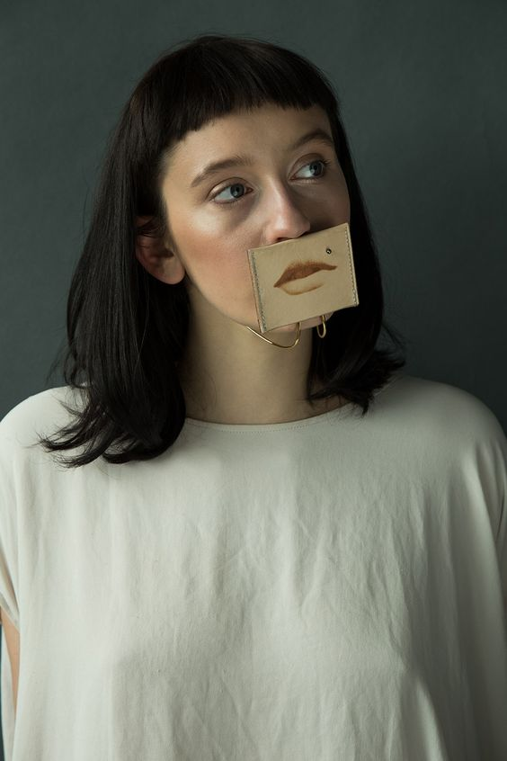 Akiko Shinzato. Piece: Putting on Someone's Identity, 2015. Brass, laser engraved leather, reflective plastic. Photo by: Runa Anzai. Model: Kitty Garrett. Hair& Makeup: Yoko Minami . .:
