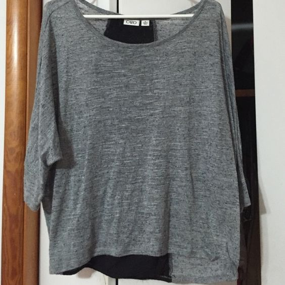 Grey top Soft grey top with a black lace stripe down the back. Cato Tops Blouses