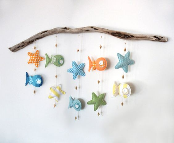 I want to try to make this using a piece of driftwood I have- with different things hanging from it...maybe starfish?