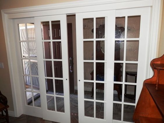 Interior sliding French doors with two matching sidelights. This a custom design and custom installation. The sliding doors are hung on 'Johnson' hardware track.