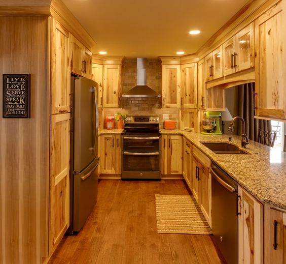 Kitchen Cabinets And Slate Appliances With Tile Backsplash And Kitchen