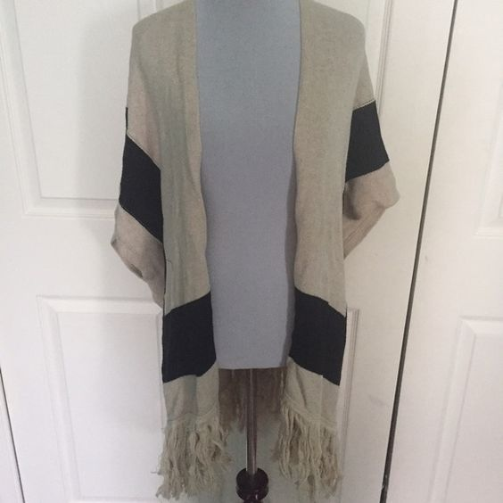 Poncho Style Fringe Boho Cardigan cute boho cardigan with almost poncho styled sleeves and fringe at the bottom. it is in a tan color with black detailing Forever 21 Sweaters Cardigans