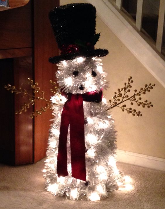 Snowman, made for tomato cages, tinsel garland, and les lights. The cages were small, I used 24 ft of garland, but should have used 36. I used 100 count string of white lights and that was adequate. I found the mini ornaments and hat at our local Meijer megastore.