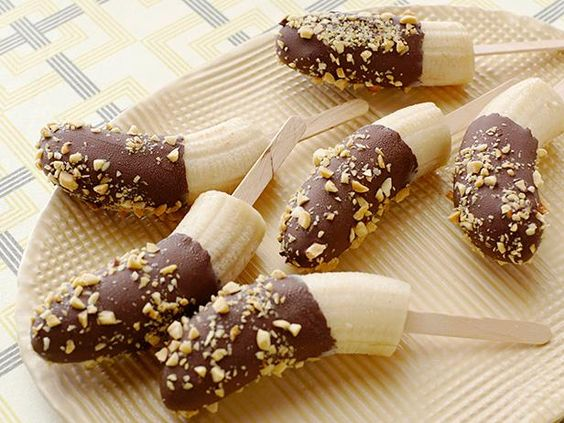 Recipe of the Day: Chocolate-Covered Banana Pops.   The key to making this recipe is starting with frozen bananas. Once the fruit is firm, dunk it in melted chocolate and finish with chopped peanuts for a crunchy finish.