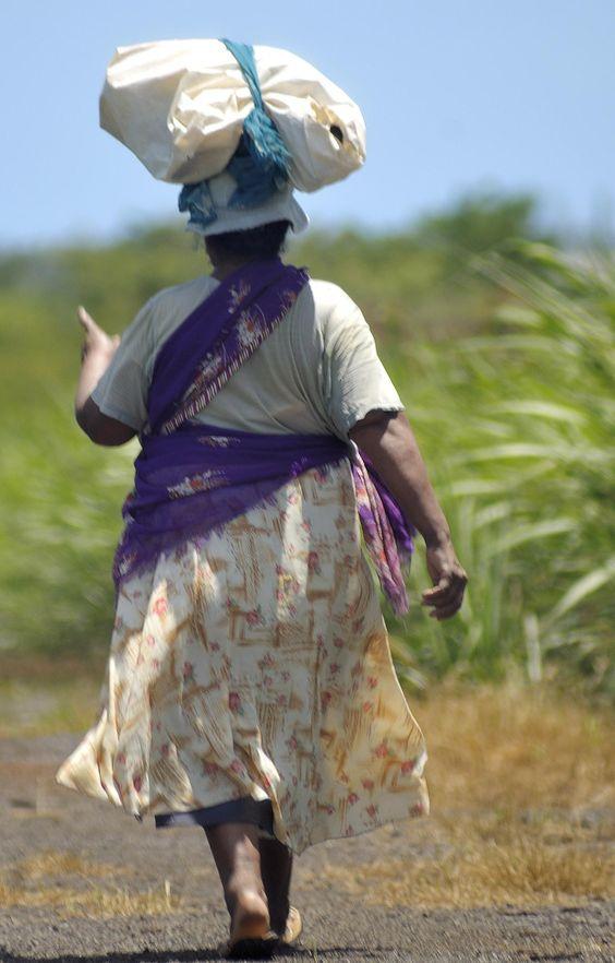 Sugarcane worker in Mauritius by Le Meridien Ile Maurice. Femme travaillant aux champs de canne à l'Ile Maurice by Le Meridien Ile Maurice.: