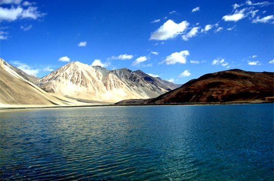 "Ladakh  -- Ladakh ""land of high passes"" is a region of India in the state of Jammu and Kashmir that extends from the Kuen Lun mountain range in the north to the main Great Himalayas to the south, inhabited by people of Indo-Aryan and Tibetan descent."